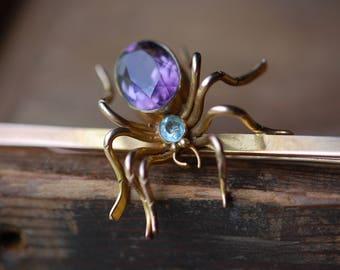 Antique 1910s 9 CT amethyst and aquamarine spider bar pin