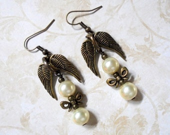 White Pearl Earrings with Brass Wings and Bows (3747)