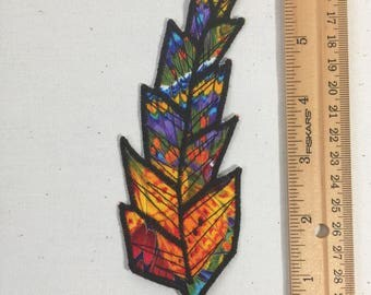 Brightly colored feather fabric patch