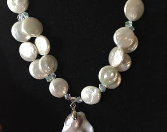 Beautiful fresh water Coin Pearls accented with s Mother of Pearl Pendant, Crystals and Sterling Silver beads. One of  kind.