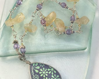 Handcrafted Dichroic glass pendant necklace with Sterling Silver chain. Mauve Floral