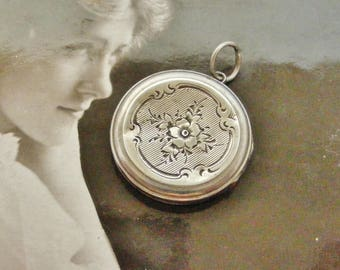 Antique French silver locket with hand written paper fragment