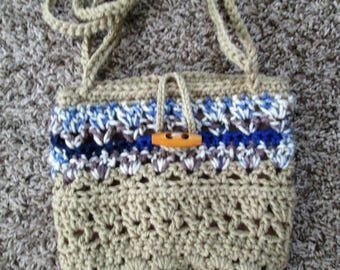 Fully lined crochet purse, light brown, blues, browns, cream, wood toggle button and loop closure