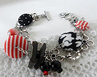 Bracelet in black, red and white fabrics, rabbits, stripes and peas