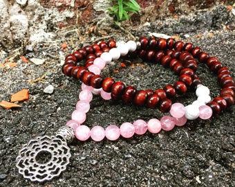 Yogi-inspired 108 wood bead mala meditation necklace with rose quartz and crown chakra pendant
