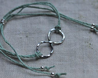 Naturally dyed hemp friendship bracelet with hand forged sterling silver infinity charm