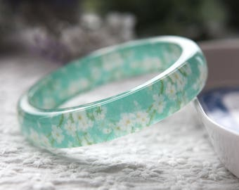 Resin bangle with embedded Japanese floral art