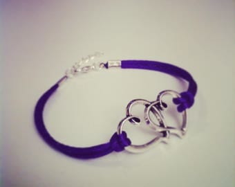Bracelet large purple cord with two entwined hearts