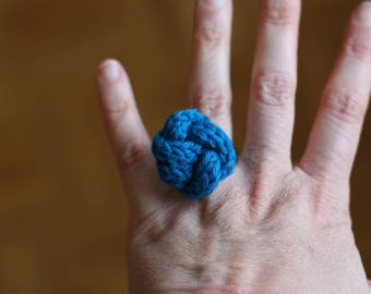 Teal bow tie ring