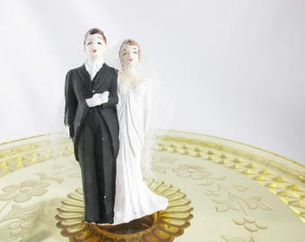 """Tiny Bridal Couple Cake Topper - Chalkware Figures With Net Cover - 3 1/2"""" Tall Cake Topper - Tux and Empire Waist Gown - Painted Features"""