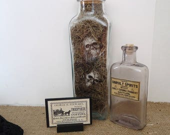 Halloween bottles creepy haunted graveyard display, undertaker sign, coffin, shrunken heads, spirits, Halloween jars, skeletons