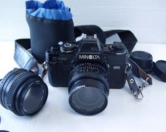 Minolta X-700  SLR Manual Focus 35mm Camera.  With 50mm 1.7 Lens And 24mm 2.0 Lens.