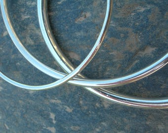 Bangle is round 2 mm sterling silver wire.