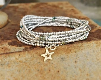 Handmade extra long stacking wrap bracelet with various silver tone seed beads and crystal beads with a sterling silver star charm