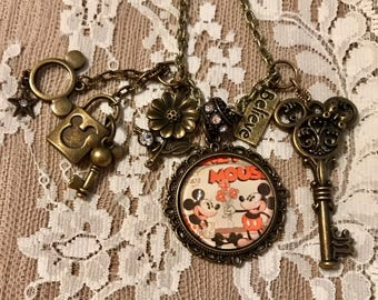 Vintage Style Pendant Necklace Mr. M.Mouse and Miss Minnie Theme. In Antique Bronze Tone.