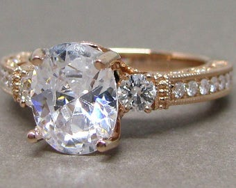 Oval Forever One Moissanite 3 Stone Diamond Engagement Ring 14k Rose Gold 9x7mm Colorless