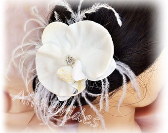 White orchid hair clip, bridal flower and feathers wedding day hair accessories.