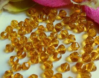 set of 80 xilion bicone glass beads