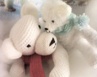 CUDDLY bear and her baby in white
