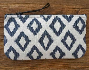 Blue and off-white jacquard fabric pouch