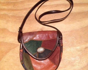 Vintage shoulder bag made of patches leather and suede.