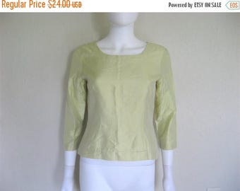ON SALE 90s Silk Green Button Down top