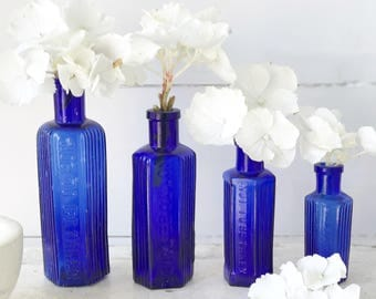 A set of four cobalt blue Victorian poison bottles