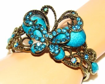 Butterfly Bracelet - Ocean Blue Rhinestone On A Spring Load Gold Tone Cuff - New - Unused -FREE SHIPPING.