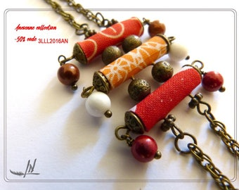 Bracelet in textiles and beads metal bronze.