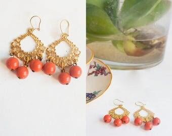 Statement Art Deco style earrings. Golden metal and coral earrings. Chandelier style Vintage earrings.