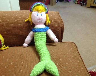 Hand knitted mermaid with a green tail