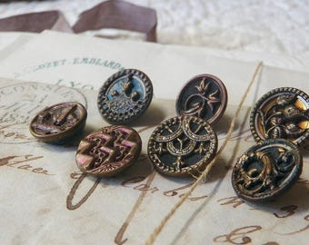 7 Small Victorian Brass Buttons 1880s Pressed Pierced Tinted