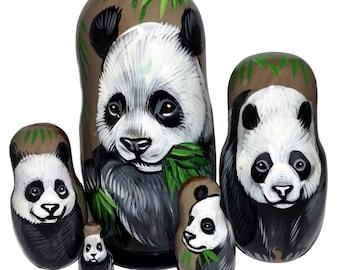 Panda on Five Russian Nesting Dolls. Wild Life.