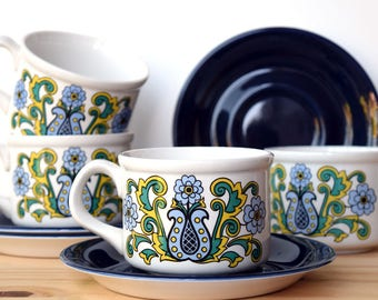Vintage Staffordshire potteries tea cups with a retro floral design - set of two cups and saucers