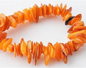 Mother of pearl beads, orange chips 4 to 18 mm by 30 pieces