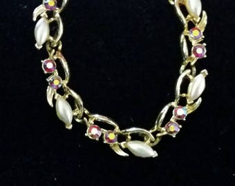 Faux pearl and aurora rhinestone necklace by BSK - vintage gold tone metal
