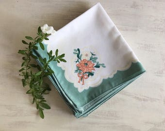 A Set of 8 Large Napkins With Green Borders, Peach Flowers