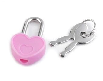 2 cadenas coeur rose avec clés