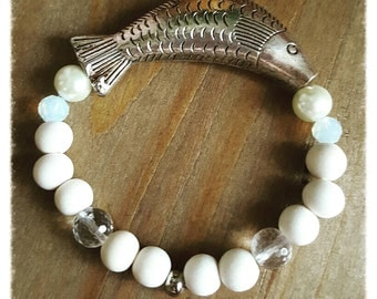 Fish pewter center surrounded by pearls, Swarovski crystals amd wood beaded bracelet by Moonphenom