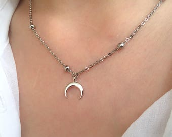 Necklaces with steel chain with beads and crescent pendant