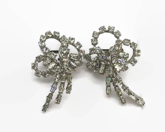 Large vintage crystal rhinestone earrings in the shape of a fancy bow, screw backs, rhodium plated siver metal, circa 1950s