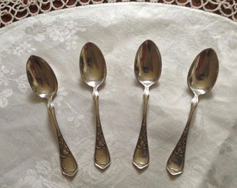 Silver plate demitasse spoons in charming Iris pattern by E.C. Ely c. 1902.  Set of four in pristine condition