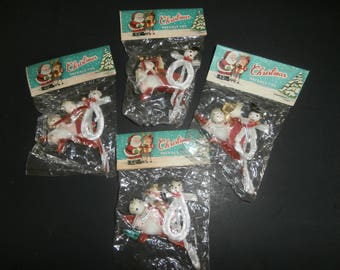Vintage Christmas decoration package ties 4 packages of 4 each in original bag never opened snowman Santa angel marked Japan