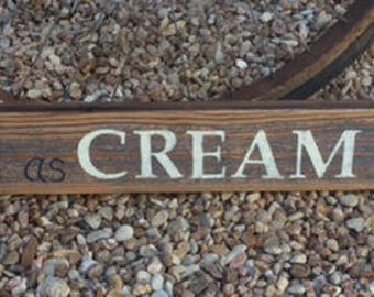 Fine as Cream Pie painted sign on old barn wood