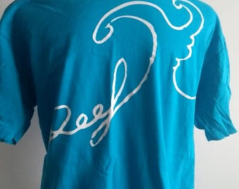 Mens blue reef teeshirt with reef and wave front design.