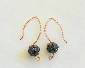 Capri blue crystals adorn 8mm beads, and they are mounted on hand made twisted gold wires.  Beautiful 1 inch drop.