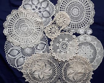 Set of white, cream and beige vintage doilies