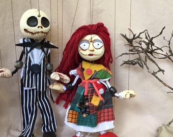 """Jack Skellington and Sally puppet marionettes from Tim Burton's """"The Nightmare Before Christmas"""""""