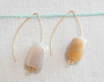 Open hoop earrings with natural grey stones