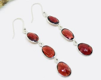 Garnet earrings set in Sterling silver (92.5). Genuine natural garnet stones earring. Perfectly matched. Length-2.25 inch